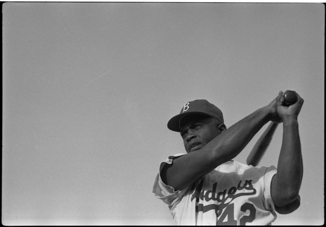 Jackie Robinson in Brooklyn Dodgers uniform, swinging bat, 1954. Library of Congress Prints & Photographs Division, LC-DIG-ppmsc-00047.