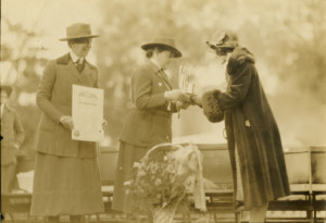 Juliette Gordon Low on a stage receiving an award.